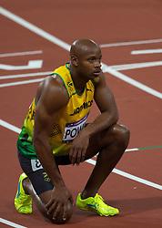 THEMENBILD - Vier Wochen vor Beginn der Freiluft-Weltmeisterschaften in Moskau wird die Leichtathletik gleich von mehreren Dopingfällen hochkarätiger Athleten erschüttert. Am 14. Juli gab zuerst US-Topsprinter Tyson Gay bekannt, eine positive Probe abgegeben zu haben. Wenig später folgte der frühere 100-m-Weltrekordler Asafa Powell aus Jamaika. Hier im Bild Asafa Powell am 05.08.2012 im Olympia Stadion in London nach dem 100m Finale der Herren bei den olympischen Spielen 2013 // THEMES IMAGE - four weeks before the start of the outdoor World Championships in Athletics in Moscow is the same shaken by several high-profile cases of doping athletes. On 14 July was first known U.S. top sprinter Tyson Gay, to have given a positive sample. A little later, the former 100-meter world record holder Asafa Powell of Jamaica followed. Picture Show, Asafa Powell on 2012/08/05 at the Olympic Stadium in London after the men's 100m final at the Olympic Games 2013. EXPA Pictures © 2012, PhotoCredit: EXPA/ Johann Groder