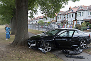 The aftermath of a crashed Audi car that has crashed through railings of Ruskin Park, a public space in Herne Hill on 21st August 2020, in London, United Kingdom. The car was seen speeding through Ferndene Road, a residential street in Lambeth, bouncing off a speed hump at great speed, colliding with a parked car and crashing through railings. The two occupants left the scene on foot and no-one was injured. (photo by Richard Baker/In Pictures via Getty Images)