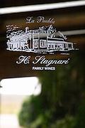 Glass door with the inscription La Puebla H Stagnari Family Wines. Bodega Vinos Finos H Stagnari Winery, La Puebla, La Paz, Canelones, Montevideo, Uruguay, South America