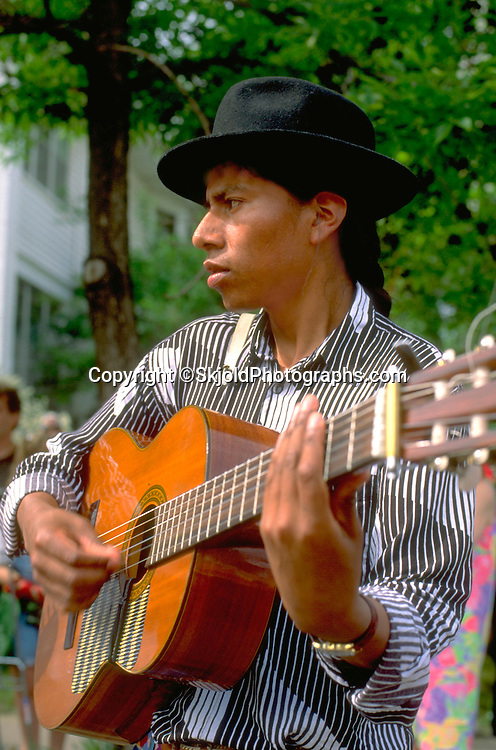 South American age 24 playing Andean guitar music at Grand Old Day .  St Paul  Minnesota USA