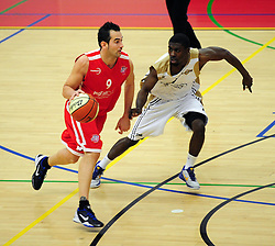 Bristol Academy Flyers' Fran Robles attempts to dribble past Essex Leopards' Ishmael Fontaine - Photo mandatory by-line: Dougie Allward/JMP - Tel: Mobile: 07966 386802 23/03/2013 - SPORT - Basketball - WISE Basketball Arena - SGS College - Bristol -  Bristol Academy Flyers V Essex Leopards