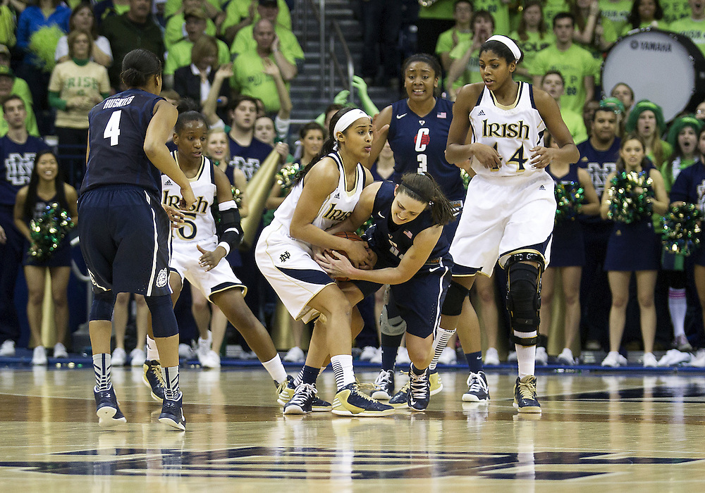 March 04, 2013:  Notre Dame guard Skylar Diggins (4) ties up Connecticut guard Kelly Faris (34) for a jump ball during NCAA Basketball game action between the Notre Dame Fighting Irish and the Connecticut Huskies at Purcell Pavilion at the Joyce Center in South Bend, Indiana.  Notre Dame defeated Connecticut 96-87 in triple overtime.