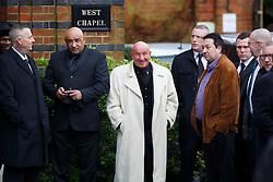 © licensed to London News Pictures. London, UK 03/01/2014. Former gangster Dave Courtney and mourners attending to the funeral of Great Train Robber Ronnie Biggs at Golders Green crematorium in north London. Biggs died on December 18, 2013 aged 84 after famously spent 35 years on the run from prison. Photo credit: Tolga Akmen/LNP