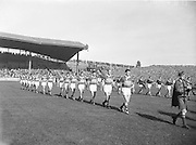 Kerry and Galway parade onto the pitch led by the Artane Boys Band before the All Ireland Senior Gaelic Football Championship Final, Kerry vs Galway in Croke Park on the 27th September 1959. Kerry 3-7 Galway 1-4.