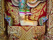 30 JANUARY 2016 - NONTHABURI, NONTHABURI, THAILAND: The feet of a Buddha statue at Wat Bua Khwan, a large Buddhist temple in Nonthaburi, north of Bangkok, Thailand.        PHOTO BY JACK KURTZ