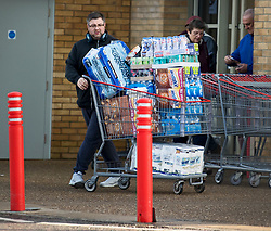 © Licensed to London News Pictures. 03/11/2020. Watford, UK. A shopper pushes a trolly fully of supplies from COSTCO in Watford, Hertfordshire ahead of a second national lockdown later this week. Strict measures are due to be re-introduced in an attempt to fight a second wave of the COVID-19 strain of Coronavirus. Photo credit: Ben Cawthra/LNP