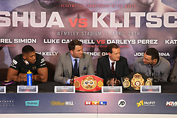 27 April 2017 - Boxing - Anthony Joshua v Wladimir Klitschko Press conference - Promoter Eddie Hearn and Sky TV's Adam Smith look on as Anthony Joshua and Wladimir Klitschko respond to questions from the press - Photo: Marc Atkins / Offside.