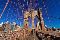 Pedestrians walking over Brooklyn Bridge to Manhattan, New York, New York USA.