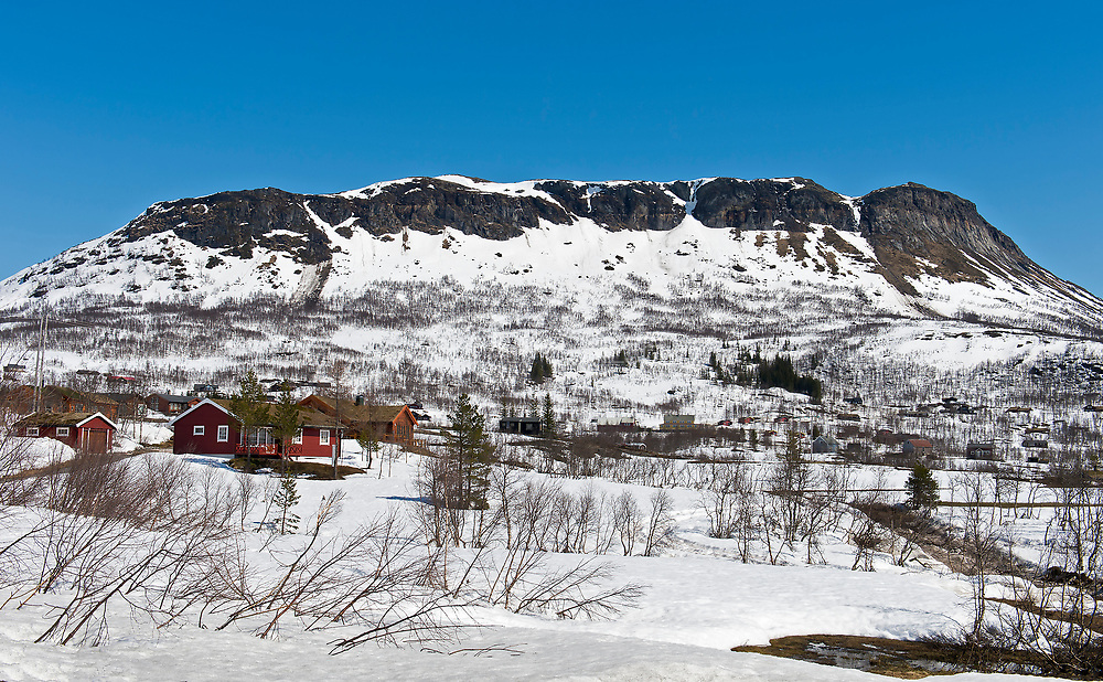 The small cabin community called Solbakken in Sysendalen, Eidfjord (Hordaland, Norway). In the background is the mountain range Grytehorga reaching 1223 meters above the sea. Photo from mid May 2015.