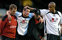 Photo: Gareth Davies.<br />Fulham v Reading. The Barclays Premiership. 25/11/2006.<br />Fulham's Frank Queudrue (2nd Left) is taken off after a heavy tackle against Reading.