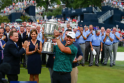 August 12, 2018 - St. Louis, MO, U.S. - ST. LOUIS, MO - AUGUST 12: Brooks Koepka (USA) hoists the Wanamaker Trophy on the 18th green after winning the PGA Championship August 12, 2018, at Bellerive Country Club in St. Louis, MO.  (Photo by Tim Spyers/Icon Sportswire) (Credit Image: © Tim Spyers/Icon SMI via ZUMA Press)