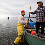 Jordin Tootoo grew up in a small village along the Hudson Bay only a hundred miles from the Arctic Circle. The first Inuit to play professionally in the National Hockey League, Tootoo spends his offseason at home where he fishes and hunts for Caribou, seal and Beluga whale. Living off the land is necessary for residents of the small village. <br /> <br /> Image available for licensing and for a personal print. Please Add To Cart and select the size and finish. All prints are delivered directly to you from the printer.