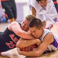 111913       Cable Hoover<br /> <br /> Miyamura Patriot Daniel Jimm (30) wrestles the ball from Aztec Tiger Dylan Stinson (25) Tuesday at Miyamura High School.