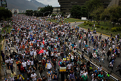 A group of opposition supporters arrive at the Francisco Fajardo Expressway to join the demonstration against President Nicolás Maduro in Caracas, Venezuela on May 3, 2017.