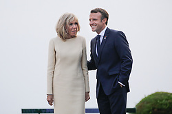French President Emmanuel Macron and his wife Brigitte await heads of state at the Biarritz lighthouse, southwestern France, ahead of a working dinner on August 24, 2019, on the first day of the annual G7 Summit. Photo by Thibaud Moritz/ABACAPRESS.COM