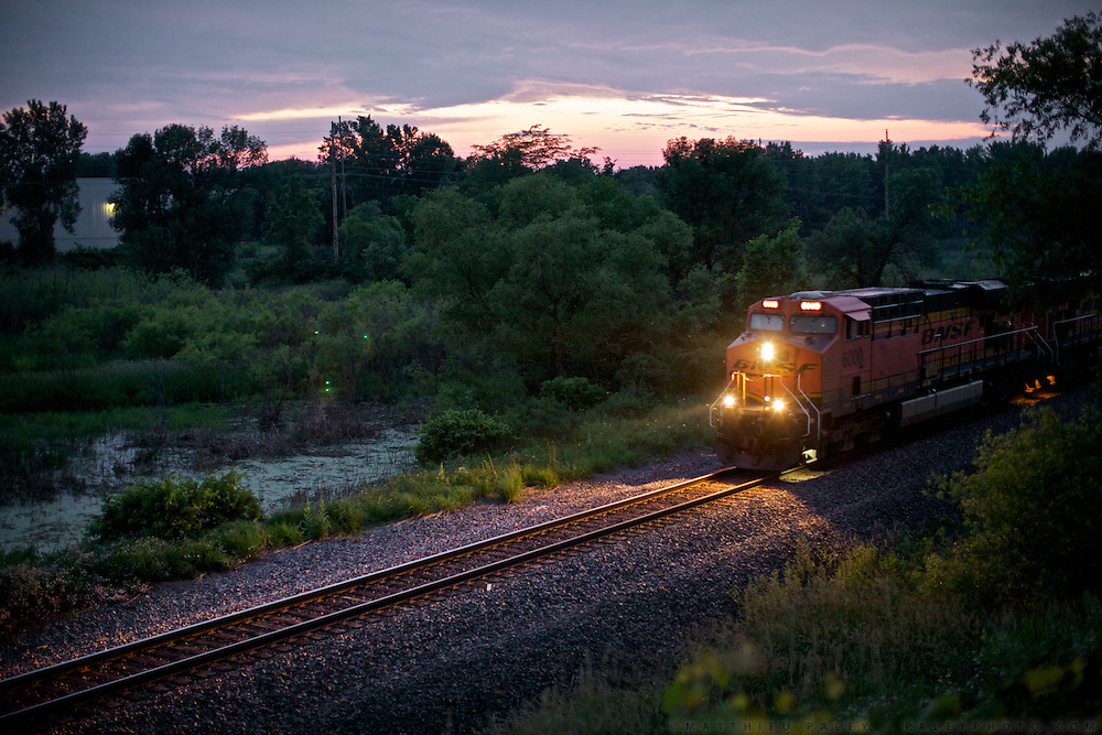 """Hopping freight train from  La Crosse to Bay View (along the Mississipi river) near Milwaukee, with 43 year old Hobo named Stretch. ..Life of a Hobo nicknamed Stretch. Stretch was elected Hobo King in 2009, at the National Hobo convention. A Hobo is a term which is applied to a migratory worker or homeless vagabond, often penniless. Hobos move around the country, looking for work by hopping illegally on freight trains, which can be a dangerous enterprise. Modern freight trains are much faster and harder to ride than in the 1930s, but can still be boarded in railyards..The first and most important rule of the hobo code is 'decide your own life', which meant 'do what you want to do'...A 4-weeks road trip across the USA, from New York to San Francisco, on the steps of Jack Kerouac's famous book """"On the Road"""".  Focusing on nomadic America: people that live on the move across the US, out of ideology or for work reasons."""