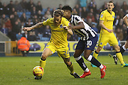 Millwall midfielder Fred Onyedinma (10) battles for possesion with with Bristol Rovers midfielder Stuart Sinclair (24)  during the EFL Sky Bet League 1 match between Millwall and Bristol Rovers at The Den, London, England on 12 November 2016. Photo by Matthew Redman.