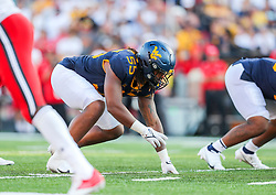 Sep 4, 2021; College Park, Maryland, USA; West Virginia Mountaineers defensive lineman Dante Stills (55) lines up during the fourth quarter against the Maryland Terrapins at Capital One Field at Maryland Stadium. Mandatory Credit: Ben Queen-USA TODAY Sports
