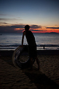 A man with his buoy made of a tire air chamber looks at the  sea in the end of a day, in the beach near Maungmagan village, Dawei, Burma.<br /> Note: Images are not distributed or sold in Portugal