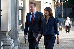 © Licensed to London News Pictures. 05/05/2016. LONDON, UK.  Prime Minister, DAVID CAMERON and his wife, SAMANTHA CAMERON arriving to cast an election vote in the London elections to elect a the new Mayor of London and London Assembly members at Westminster Methodist Central Hall this morning.  Photo credit: Vickie Flores/LNP