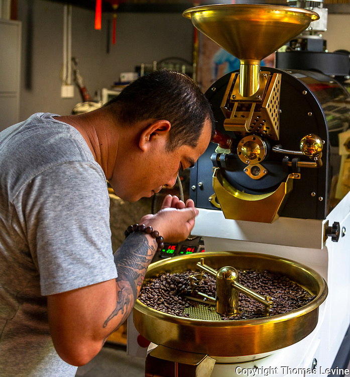 Mr. Thanh checks how the roasting is doing before taking the next step.
