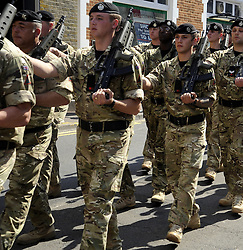 """© Licensed to London News Pictures. 01/09/2011 Maidstone, Kent, UK. Hundreds of soldiers parade through Maidstone, Kent to mark their return home from Afghanistan. Three hundred """"Tankies"""" from the 2nd Royal Tank Regiment (2RTR), many of whom are recruited from Kent, have been on active duty in Helmand Province. To celebrate the homecoming, they have paraded through Maidstone High Street today (1.09.2011) .Photo credit : Grant Falvey/LNP"""