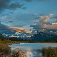 A sunset glows over Vermillion Lakes and Mount Rundle near the town of Banff.