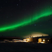 Watchee Lodge in Wapusk National Park with northern lights, Aurora Borealis, and constellation Orion at -46F in February. Canada