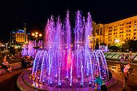 Kiev , Ukraine - August 30, 2019 : people enjoying musical fountains of Maidan square