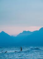 Woman surfer on Maui, HI.