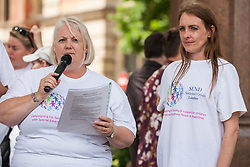 London, UK. 30 May, 2019. Sharon Pratt (l) of SEND National Crisis, seen here with co-founder Poppy Rose (r), addresses fellow campaigners attending a demonstration in Parliament Square to demand improvements in the diagnosis and assessment of young people with SEND, assistance for their families, funding and legal and financial accountability for local authorities in their treatment of young people with SEND and their families. Credit: Mark Kerrison/Alamy Live News