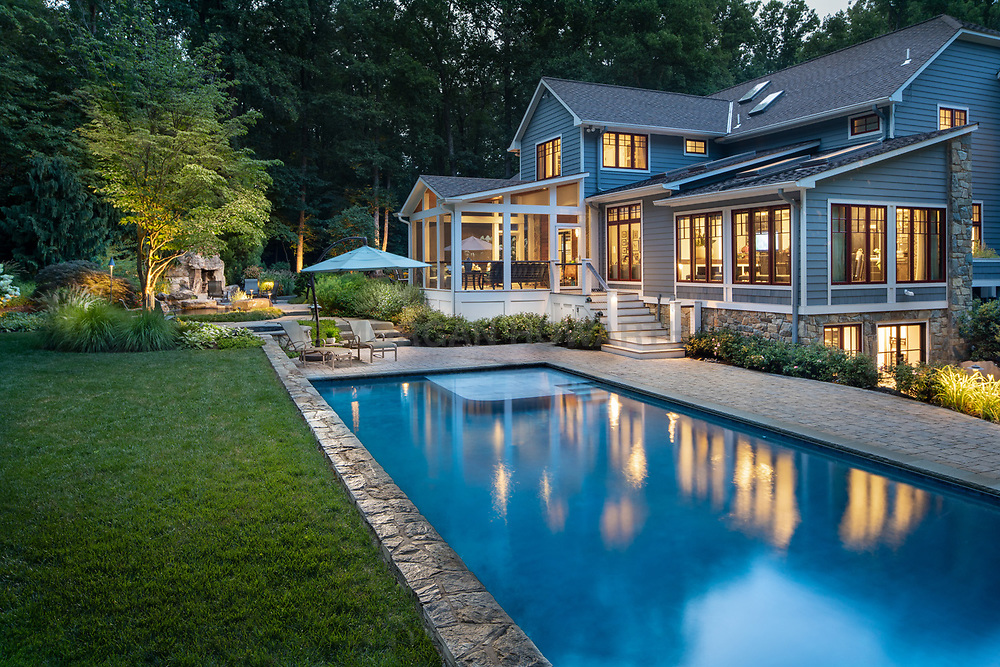 927 Hickory exterior landscaping with pool and twilight
