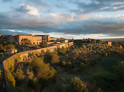 Apartment buildings and landscape on the outskirts of the medieval city of Siena, Tuscany, Italy