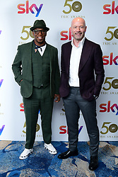 Ian Wright and Alan Shearer attending the TRIC Awards 2019 50th Birthday Celebration held at the Grosvenor House Hotel, London.