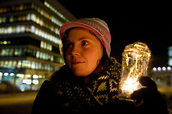 """© under license to London News Pictures.  09/12/2010 A graduate student holds a candle at a """"vigil to mark the death of education"""" in Plymouth this evening (Thursday), as the result of the vote on education fees comes in. Picture credit should read: David Hedges/LNP"""
