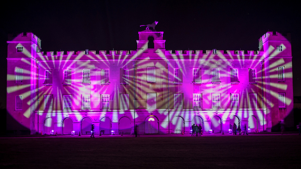 © Licensed to London News Pictures. 20/11/2015. LONDON, UK. The Enchanted Woodland opens for its 10th anniversary season at Syon House in West London.  An illuminated trail takes visitors through gardens designed by Capability Brown, round an ornamental lake and ending at the spectacular Great Conservatory.  En route, visitors view light show projected on to Syon House itself.  Photo credit : Stephen Chung/LNP