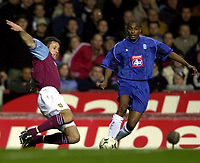Photo. Richard Lane. <br />Aston Villa v Birmingham City. Barclaycard Premiership. 03/03/2003<br />Ronnie Johnsen gets the ball away as Clinton Morrison moves in.
