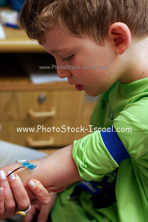Young boy of six having blood drawn from his arm for a bone marrow test. Model Release available