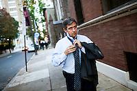Congressman Joe Sestak (D-Pa.) fixes his tie before an appearance on Fox News in Philadelphia on Nov. 2, 2009. Sestak is running against Senator Arlen Specter (D-Pa.) in the Pennsylvania primary election this spring.