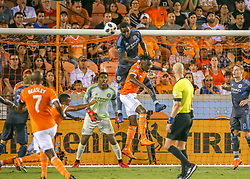 May 25, 2018 - Houston, TX, U.S. - HOUSTON, TX - MAY 25:  New York City defender Sebastien Ibeagha (33) heads the ball out of the way during the MLS match between the New York FC and Houston Dynamo on May 25, 2018 at BBVA Compass Stadium in Houston, Texas.  (Photo by Leslie Plaza Johnson/Icon Sportswire) (Credit Image: © Leslie Plaza Johnson/Icon SMI via ZUMA Press)