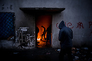 Migrants in one of the abanoned building in the old train depot. Some of them have found shelter in some old office and workshop. The majority are living in large warehouses without doors.  Belgrade, Serbia. January 14th 2016 Federico Scoppa