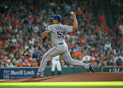 July 28, 2018 - Houston, TX, U.S. - HOUSTON, TX - JULY 28:  Texas Rangers starting pitcher Ariel Jurado (57) pitches to Houston Astros center fielder George Springer (4) in the bottom of the first inning during the baseball game between the Texas Rangers and Houston Astros on July 28, 2018 at Minute Maid Park in Houston, Texas.  (Photo by Leslie Plaza Johnson/Icon Sportswire) (Credit Image: © Leslie Plaza Johnson/Icon SMI via ZUMA Press)