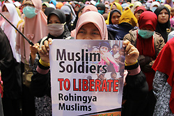 September 4, 2017 - Jakarta, Java, Indonesia - Indonesian Muslim activists who are members of the Muslim Friends of Rohingya took action at the Embassy of Myanmar, Jakarta, Indonesia. Hundreds of Muslim activists staged a demonstration denouncing the Myanmar government for continued persecution of the Rohingya Muslim minority. (Credit Image: © Edi Ismail/NurPhoto via ZUMA Press)