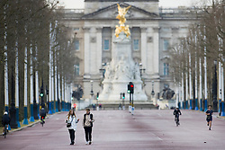 © Licensed to London News Pictures. 17/01/2021. London, UK. A man uses a pair of rollerskis on The Mall which was very quiet this morning. Foreign Secretary Dominic Raab has said that every adult in the UK will be offered a first dose of a coronavirus vaccine by September. Photo credit: Peter Macdiarmid/LNP