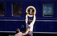 An advanceman positions the presidential seal on the campaign train of President William Clinton who was running for a second term in 1996.Ferdinand MagellanFerdinand MagellanFerdinand Magellan<br />Photo by Dennis Brack
