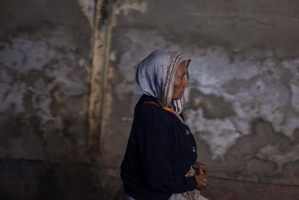 A widow walks home after a day chanting Bhajan hymns at  Sri Bagwan Bhajan