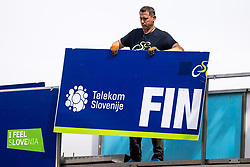 Worker with sign FIN after 2nd Stage of 27th Tour of Slovenia 2021 cycling race between Zalec and Celje (147 km), on June 10, 2021 in Slovenia. Photo by Matic Klansek Velej / Sportida