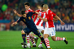 David Villa of Spain, Victor Caceres of Paraguay and Dario Veron of Paraguay during the  2010 FIFA World Cup South Africa Quarter Finals football match between Paraguay and Spain on July 03, 2010 at Ellis Park Stadium in Johannesburg. (Photo by Vid Ponikvar / Sportida)