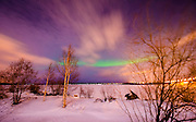 Aurora or northern lights moving across night sky in Lapland