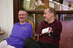 Men with disabilities chatting during bowls event held at Solihull Indoor Bowls Centre,